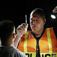"""(PSUNDAY) Marlboro 8/19/2002 EDS  BEST PHOTO PLEASE USE BIG!!!!!!!!   Marlboro Patrolman Nicholas Szymanski  conducts a field sobriety test on a subject suspect of driving under the influence.   The subject not arrested     EDS PLEASE DON""""T PUBLISH OFFICERS FIRST NAME HE REQUESTED>     Michael J. Treola Staff Photographer.......MJT"""