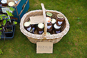 Jars of home made seville marmalade on display at a car boot sale, UK