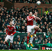 16.03.2013 Glasgow, Scotland. Anthony Stokes challenges Mark Reynolds in the air during the Clydesdale Bank Premier League match between, Celtic and Aberdeen, from Celtic Park Stadium.