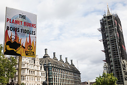 A placard used by activists from HS2 Rebellion, an umbrella campaign group comprising longstanding campaigners against the HS2 high-speed rail link as well as Extinction Rebellion activists, attending a protest rally in Parliament Square on 4 September 2020 in London, United Kingdom. The rally, and a later protest action at the Department of Transport during which activists glued themselves to the doors and pavement outside and sprayed fake blood around the entrance, coincided with an announcement by HS2 Ltd that construction of the controversial £106bn high-speed rail link will now commence.