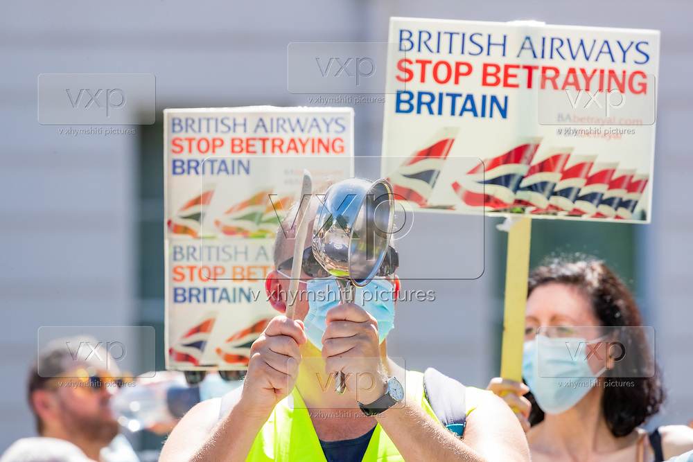 People most of them employees of the British Airways are protesting in front of the Spanish Embassy in London on Thursday, July 30, 2020. <br /> Staff and residents gathered outside the Spanish Embassy in Belgrave Square this afternoon to demonstrate against the airline's treatment of workers during the coronavirus pandemic. Protest leaders Unite union are calling for the British government to speak out against British Airways' (BA) plans to dismiss 42,000 staff and rehire 30,000 on what the union calls 'inferior contracts'. <br /> Some of the British MPs have supported BA workers, with over 160 of them to have signed workers pledge to strip BA of its lucrative landing slots if they don't step back. (VXP Photo/ Vudi Xhymshiti)