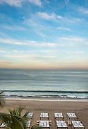 The moon sets at sunrise off the coast of Puerto Vallarta, Mexico on February 28, 2013.