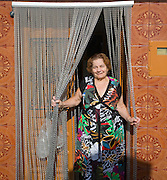 Smiling woman standing in doorway of her home Comares village, Axarquía region, Malaga province, Andalusia, Spain