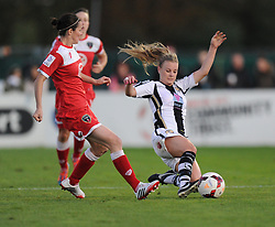 Notts County Laura Jayne tackles Bristol Academy Womens' Natalia Pablos Sanchon - Photo mandatory by-line: Alex James/JMP - Mobile: 07966 386802 - 04/10/2014 - SPORT - Football - Bristol - Stoke Gifford Stadium - Bristol Academy Womens v Notts County Ladies - Womens Super League