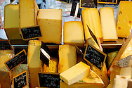 Whole Cheese ready to cut on a cheese stall at a market in Honfleur Normandy France