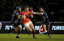 Saracens Owen Farrell breaks through as Sale Sharks Denny Solomona (right) tackles during the European Champions Cup, pool three mach at the AJ Bell Stadium, Salford.