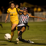 CSUN player Camille Watson (5) battles for the ball with Long Beach State player Rocio Rodriguez (5) during their playoff match at George Allen Field in Long Beach, Calif., on Nov. 3, 2016.