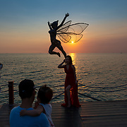 Tourists taking photos in Sunset Sanato beach, Phu Quoc