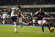 Son Heung-Min of Tottenham Hotspur takes a shot for goal past Winston Reid of West Ham United. Barclays Premier league match, Tottenham Hotspur v West Ham Utd at White Hart Lane in London on Sunday 22nd November 2015.<br /> pic by John Patrick Fletcher, Andrew Orchard sports photography.