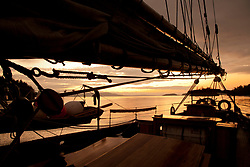 United States, Washington, San Juan Islands, silhouette of historic schooner Adventuress anchored at sunset