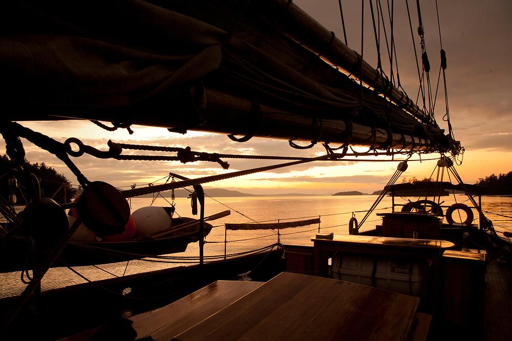 United States, Washington, San Juan Islands, silhouette of historic schooner Adventuress anchored at sunset