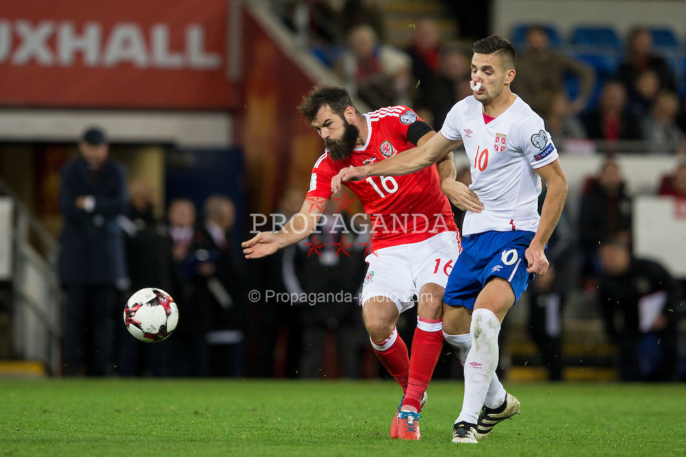 CARDIFF, WALES - Saturday, November 12, 2016: Wales' Joe Ledley in action against Serbia's Dušan Tadić during the 2018 FIFA World Cup Qualifying Group D match at the Cardiff City Stadium. (Pic by David Rawcliffe/Propaganda)