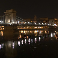 Chain bridge is seen with decoration lights turned off during Earth Hour in downtown Budapest, Hungary on March 28, 2020. ATTILA VOLGYI