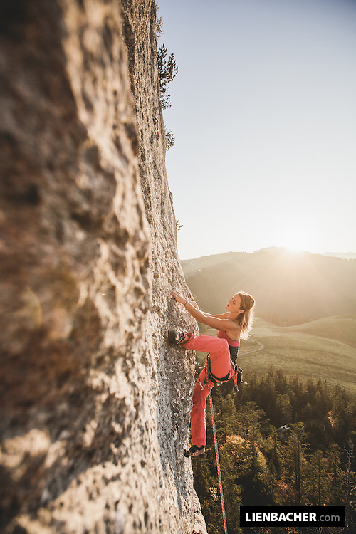Hedi Friedl climbing an easy route in the sunset. Dietrichshorn, Loferer Alm