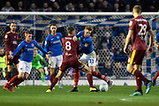 Ronan Curtis (11) of Portsmouth battles for possession with Cole Skuse (8) of Ipswich Town during the EFL Sky Bet League 1 match between Portsmouth and Ipswich Town at Fratton Park, Portsmouth, England on 21 December 2019.