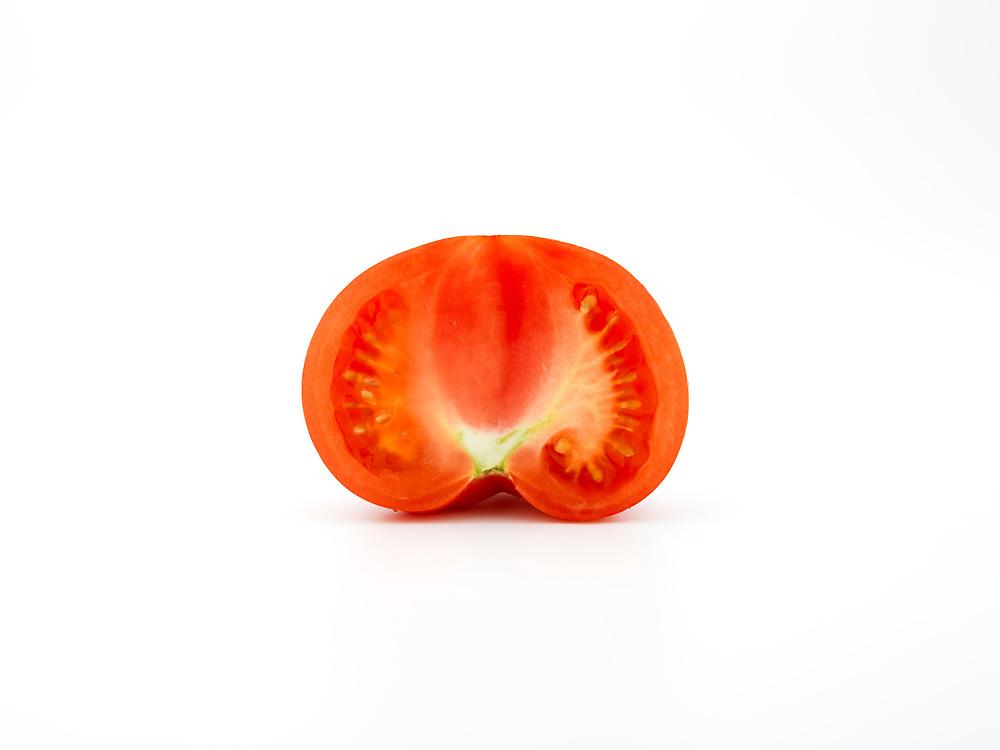 tomato half on a white background