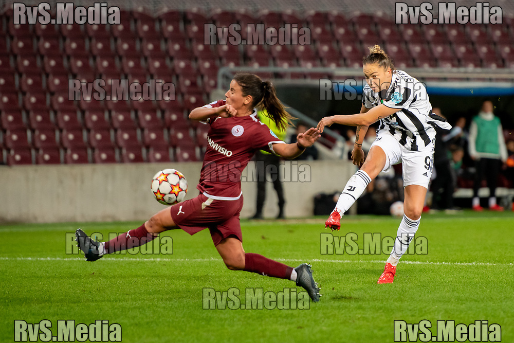 GENEVA, SWITZERLAND - OCTOBER 06: Andrea Staskova #9 of Juventus Women shoots on goal in font of Monica Mendes #16 of Servette FC Chenois feminin during the UEFA Women's Champions League group A match between Servette FCCF and Juventus at Stade de Geneve on October 6, 2021 in Geneva, Switzerland. (Photo by Basile Barbey/RvS.Media)