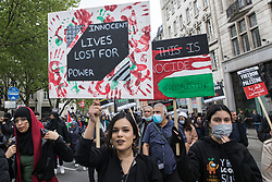 London, UK. 22nd May, 2021. Tens of thousands of people take part in the National Demonstration for Palestine. It was organised by pro-Palestinian solidarity groups in protest against Israel's recent attacks on Gaza, its incursions at the Al-Aqsa mosque and its attempts to forcibly displace Palestinian families from the Sheikh Jarrah neighbourhood of East Jerusalem.