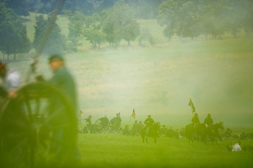 As cavalry patrols the front line, federal artillery fires upon the confederate lines during Pickett's Charge at the finale of the Blue Gray Alliance reenactment during events marking the 150th anniversary of the Battle of Gettysburg, in Gettysburg, Pennsylvania June 30, 2013.  The Battle of Gettysburg was fought July 1-3, 1863, in and near the town of Gettysburg, Pennsylvania and was the battle with the highest number of casualties in the Civil War. The Union army defeated a force led by Confederate General Robert E. Lee in what is often described as the turning point of the war.