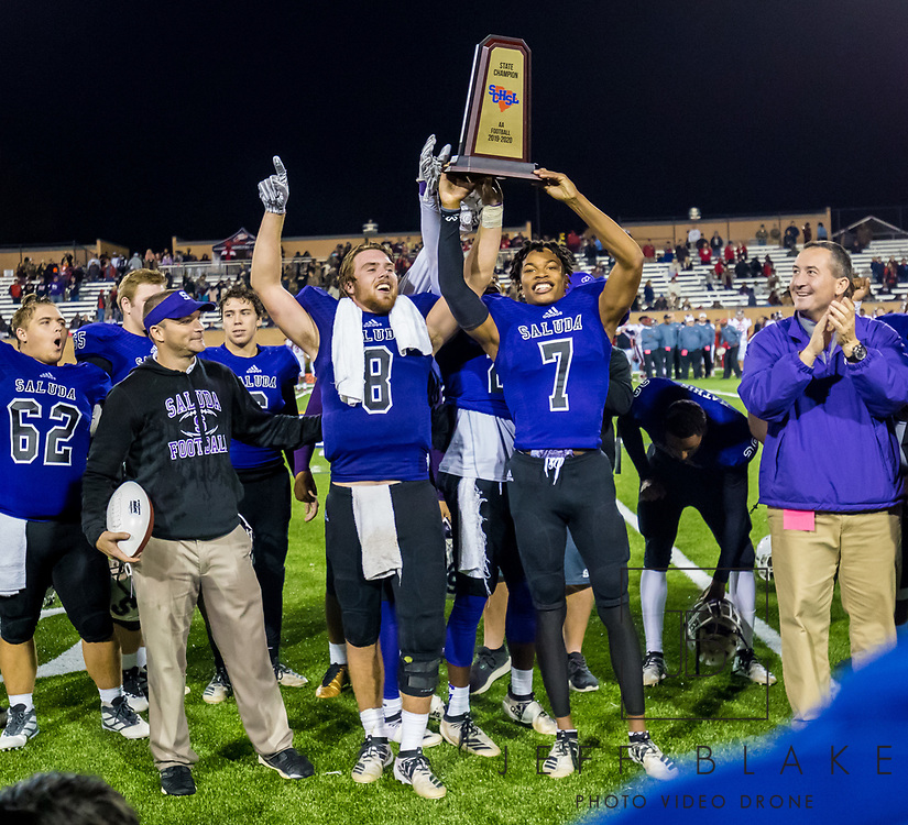 Saluda Tigers quarterback Noah Bell (8) and Saluda Tigers Dallan Wright (7) hold up the trophy after winning the Class AA State Championship game against the Barnwell Warhorses. 2019 Saluda State Championship Football Photos