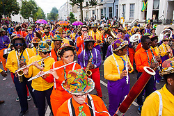 London, August 24th 2014. Revellers participate in 2014's Notting Hill Carnival in London, celebrating West Indian and other cultures, and attracting hundreds of thousands to Europe's biggest street party.