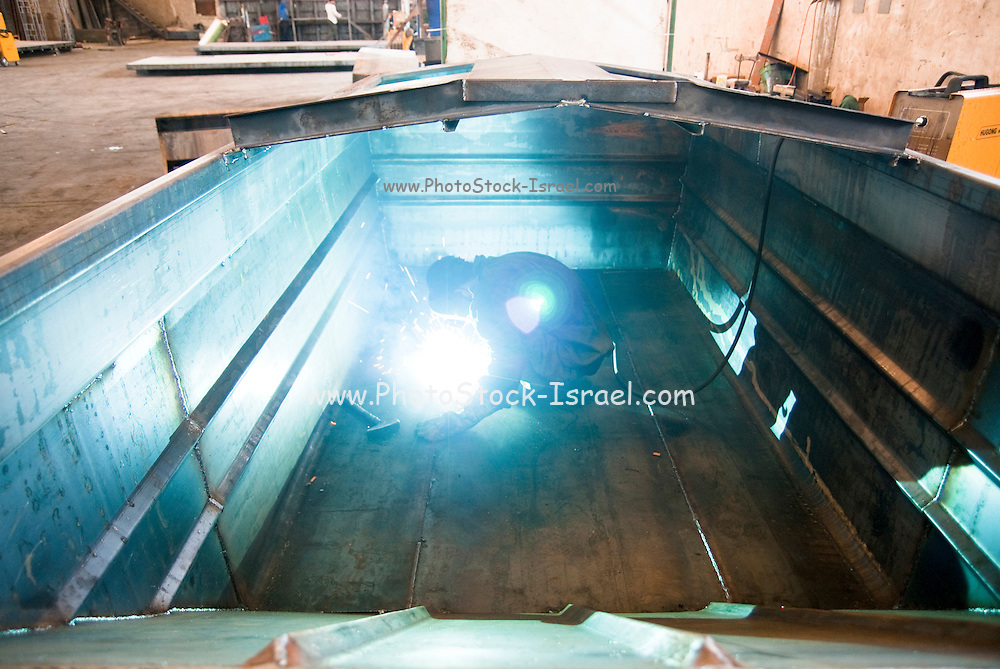 Metal workshop production line Manufacturing a truck cart Welding the cart