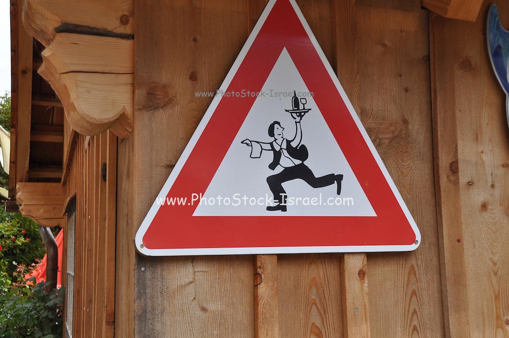 The town of Hallstatt, UNESCO World Heritage Site, on Halstatter See in the Hallstatt and Dachstein region, Upper Austria, Austria Beware of the running waiter sign
