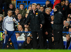 Jose Mourinho (POR), seeking his 100th Barclays Premier League win as Chelsea manager, gives Man Utd Manager David Moyes (SCO) a look as he walks behind him in the dugout during the match - Photo mandatory by-line: Rogan Thomson/JMP - Tel: 07966 386802 - 19/01/2014 - SPORT - FOOTBALL - Stamford Bridge, London - Chelsea v Manchester United - Barclays Premier League.