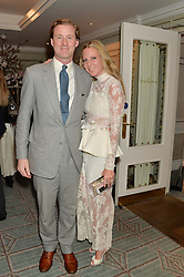ALICE NAYLOR-LEYLAND and her husband TOM NAYLOR-LEYLAND at the launch of Mrs Alice in Her Palace - a fashion retail website, held at Fortnum & Mason, Piccadilly, London on 27th March 2014.