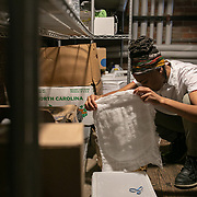 ASHEVILLE, NC - JUNE 29: Chef Ashleigh Shanti of Benne on Eagle, checks on ferments in a storage room at her restaurant on Eagle Street in Asheville, NC on Saturday June 29, 2019. (Photo by Logan Cyrus / The New York Times)