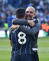 BRIGHTON, ENGLAND - MAY 12:  Manchester City manager Pep Guardiola hugs Ilkay Gundogan (8) of Manchester City as they celebrate winning the Premier League title at full time with his team mates during the Premier League match between Brighton & Hove Albion and Manchester City at American Express Community Stadium on May 12, 2019 in Brighton, United Kingdom. (MB Media)