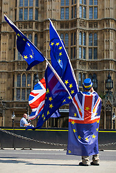 © Licensed to London News Pictures. 08/05/2018. London, UK. Anti-Brexit protesters wave EU and Union Jack flags opposite Parliament. Prime Minister Theresa May's proposal for a post-Brexit EU customs partnership has been attacked by Foreign Secretary Boris Johnson.  Photo credit: Rob Pinney/LNP