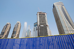 Skyline of skyscrapers under construction in Marina district of Dubai United Arab Emirates