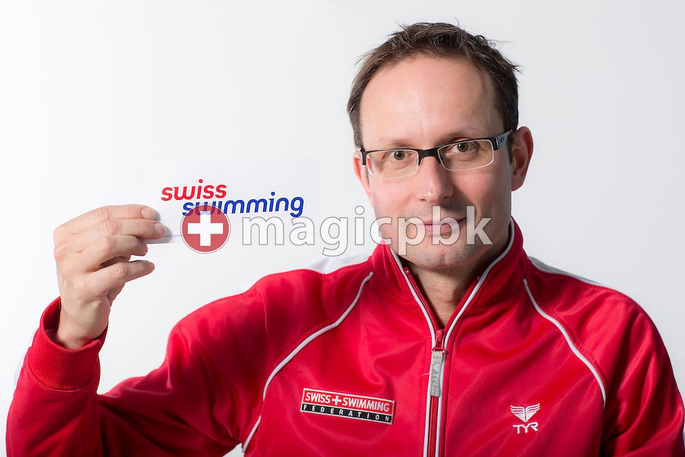Swiss Swimming Chief Junior and Youth Swimming Adrian ANDERMATT of Switzerland poses with Swiss Swimming sticker during a portrait session during the International Swim Meet Uster 2014 in Uster, Switzerland, Saturday, Jan. 25, 2014. (Photo by Patrick B. Kraemer / MAGICPBK)