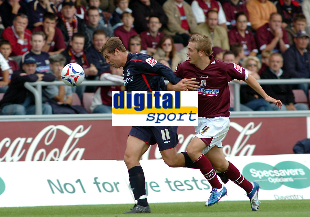 Photo: Kevin Poolman.<br />Northampton Town v Nottingham Forest. Coca Cola League 1. 12/08/2006. Forest's Grant Holt (L) and Luke Chambers fight it out.