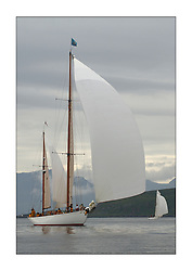 Belle Adventure, a 94' Bermudan Ketch built by Wm Fife in 1929 cruising down the Clyde with Arran's hills appearing in the background. ..This the largest gathering of classic yachts designed by William Fife returned to their birth place on the Clyde to participate in the 2nd Fife Regatta. 22 Yachts from around the world participated in the event which honoured the skills of Yacht Designer Wm Fife, and his yard in Fairlie, Scotland...FAO Picture Desk..Marc Turner / PFM Pictures