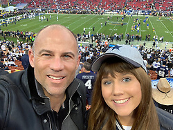 """Michael Avenatti releases a photo on Twitter with the following caption: """"""""Great night for football at the Coliseum and my daughter's first NFL playoff game."""""""". Photo Credit: Twitter *** No USA Distribution *** For Editorial Use Only *** Not to be Published in Books or Photo Books ***  Please note: Fees charged by the agency are for the agency's services only, and do not, nor are they intended to, convey to the user any ownership of Copyright or License in the material. The agency does not claim any ownership including but not limited to Copyright or License in the attached material. By publishing this material you expressly agree to indemnify and to hold the agency and its directors, shareholders and employees harmless from any loss, claims, damages, demands, expenses (including legal fees), or any causes of action or allegation against the agency arising out of or connected in any way with publication of the material."""