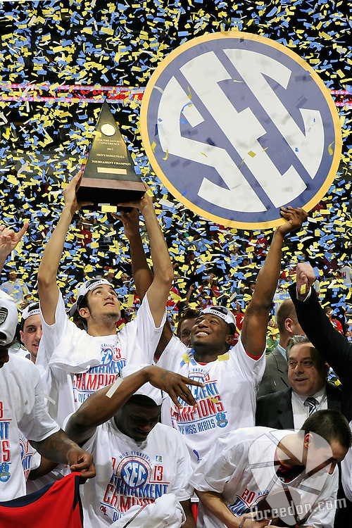 NASHVILLE, TN - MARCH 17:  Reginald Buckner and Anthony Perez of the Ole Miss Rebels celebrates a 66-63 victory over the Florida Gators in the SEC Baskebtall Tournament Championship Game at the Bridgestone Arena on March 17, 2013 in Nashville, Tennessee.  (Photo by Frederick Breedon/Getty Images)
