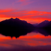 Rocky Mountains reflect in Lake McDonald in Glacier National Park, MT.