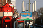 A 1998 view along Queesntown Road in Battersea and including the four tall chimneys of Battersea Power Station, on 25th March 1998, in London, England.