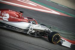 February 18, 2019 - Barcelona, Catalonia, Spain - KIMI RAIKKONEN (FIN) from team Alfa Romeo drives during day one of the Formula One winter testing at Circuit de Catalunya (Credit Image: © Matthias OesterleZUMA Wire)