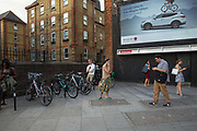 Various people outside OId Street Underground Station using mobile phones on 5th August 2016 in London, United Kingdom. From the series Our Small World, an observation of our mobile phone obsessions