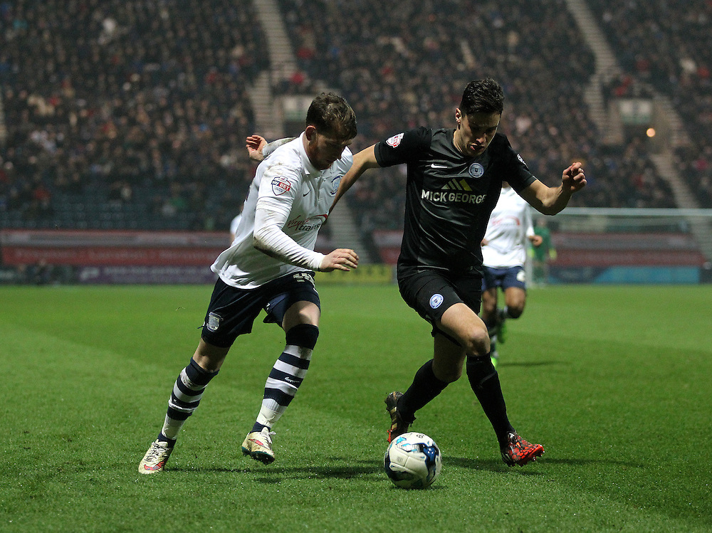 Preston North End's Joe Garner in action with Peterborough United's Michael Smith<br /> <br /> Photographer Mick  Walker/CameraSport<br /> <br /> Football - The Football League Sky Bet League One - Preston North End v Peterborough United - Tuesday 17th March 2015 - Deepdale - Preston<br /> <br /> © CameraSport - 43 Linden Ave. Countesthorpe. Leicester. England. LE8 5PG - Tel: +44 (0) 116 277 4147 - admin@camerasport.com - www.camerasport.com