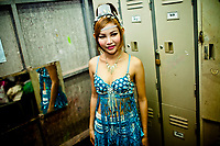 A portrait of Ant before she goes onstage at her music club in Bangkok, Thailand. Ant is a 21-year-old ladyboy performer in Bangkok, Thailand.