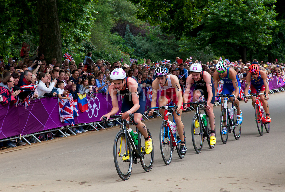 London, UK. Tuesday 7th August 2012. Men's Triathlon held in Hyde Park. Team GB athlete's Jonathan Brownlee (bronze medalist - front) and Alistair Brownlee (gold medal winner - 3rd position here) pass in the cycle section.