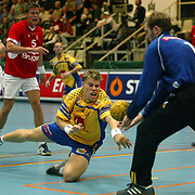 MALMOE 20021031 <br /> Robert Arrhenius fails to get the ball in the net behing goalkeeper Kasper Hvidt in the World Cup 2002 match between Sweden and Denmark October 31, 2002. Denmark won the match 33-25. <br /> PHOTO: Thommy Nyhlén/SCANPIX Code 70195
