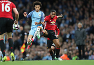 Leroy Sane of Manchester City and Antonio Valencia of Manchester United during the English Premier League match at The Etihad Stadium, Manchester. Picture date: April 27th, 2016. Photo credit should read: Lynne Cameron/Sportimage