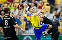 Blaz Janc of RK Celje PL vs Michal Szyba  of RK Gorenje during handball match between RK Celje Pivovarna Lasko and RK Gorenje Velenje in Eighth Final Round of Slovenian Cup 2015/16, on December 10, 2015 in Arena Zlatorog, Celje, Slovenia. Photo by Vid Ponikvar / Sportida