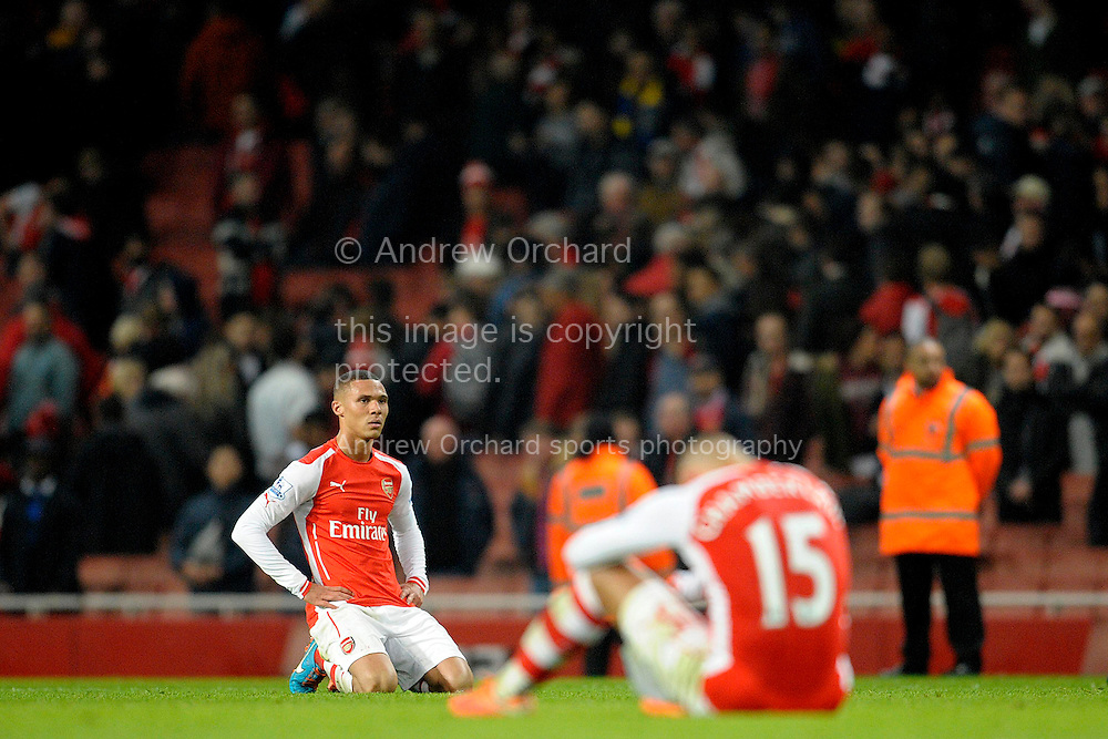 a dejected Kieran Gibbs of Arsenal on his knees after the final whistle. Barclays Premier league match, Arsenal v Manchester Utd at the Emirates Stadium in London on Saturday 22nd November 2014.<br /> pic by John Patrick Fletcher, Andrew Orchard sports photography.