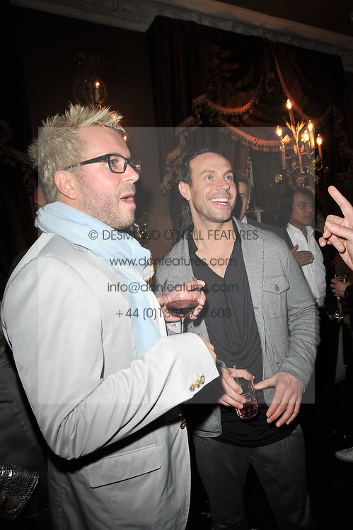 PAUL ? (Alan Carr's partner) and JASON GARDINER at a party to celebrate the publication of her new book - Kelly Hoppen: Ideas, held at Beach Blanket Babylon, 45 Ledbury Road, London W11 on 4th April 2011.